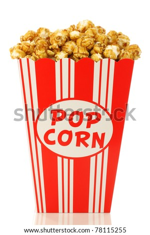 caramel popcorn in a decorative paper popcorn cup on a white background