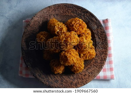Carang mas or Grubi is a sweet potato base which is shaped like a fried ball and seasoned with brown sugar. indonesian snack Zdjęcia stock ©