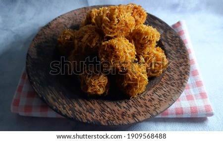 Carang mas or Grubi is a sweet potato based dish shaped like a fried ball and seasoned with brown brown sugar. Zdjęcia stock ©