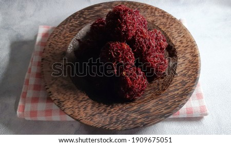 Carang mas ubi ungu or Grubi is a sweet potato base which is shaped like a fried ball and seasoned with brown sugar. Zdjęcia stock ©