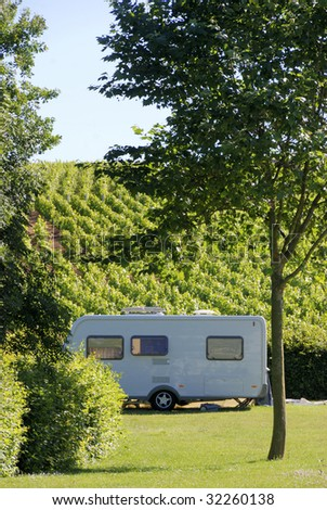 Caravan at camping in France, located between vineyards