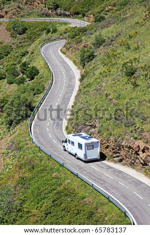 Caravan camper car motorhome home camping camp highway road van border France Spain driving holiday journey landscape lifestyle near recreational summer sightseeing trailer transport truck vehicle