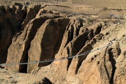 Caravan crossing suspension bridge on the way to Upper mustang Nepal