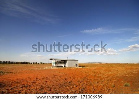 Caravan in a very old barn at Orroroo, Australia - stock photo