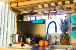 Caravan rv inside, kitchen area. Cooking in campervan. Holidays, adventure with motor home. Van life lifestyle.