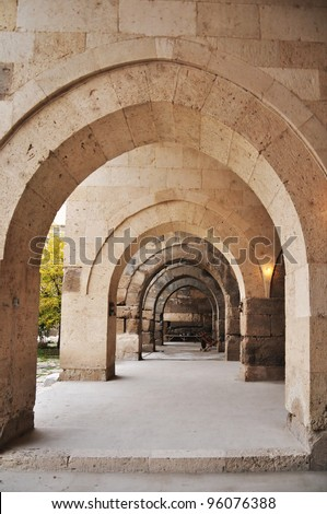 Caravanserais along the ancient silk road provided lodging, food and essential services to trade caravans. Built like forts, they offered security as well. The image shows the covered corridors.