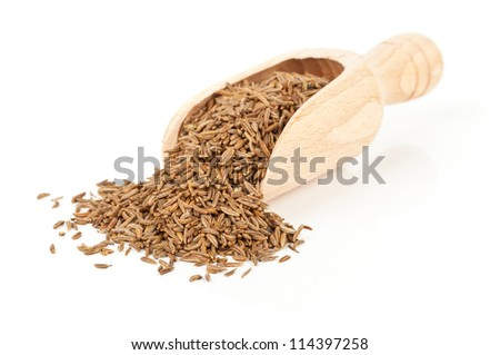 Caraway/ Cumin seeds in wooden scoop over white background