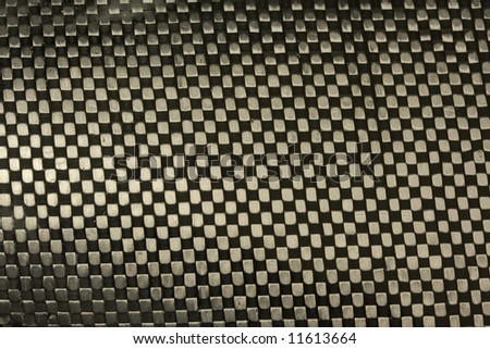 carbon fiber fabric with epoxy resin - a macro of canoe racing paddle blade