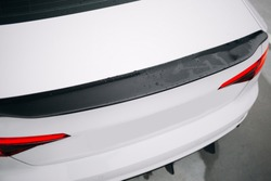 Carbon spoiler at the trunk of modern car