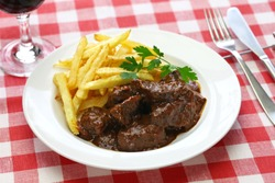 carbonade flamande with frites , flemish beef stew, belgian cuisine
