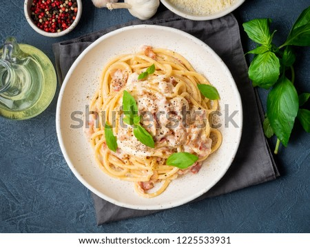 Carbonara pasta. Spaghetti with pancetta, egg, parmesan cheese and cream sauce. Traditional italian cuisine. Top view.
