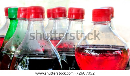 Carbonated soft drink bottles isolated on white background