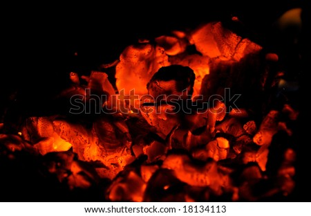 carbons of bonfire on black background
