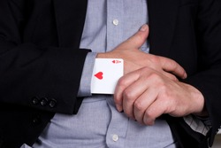 Card ace of hearts in the black sleeve of the suit