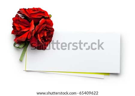 Card and roses isolated on white