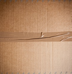 Card board box sealed with brown packing tape