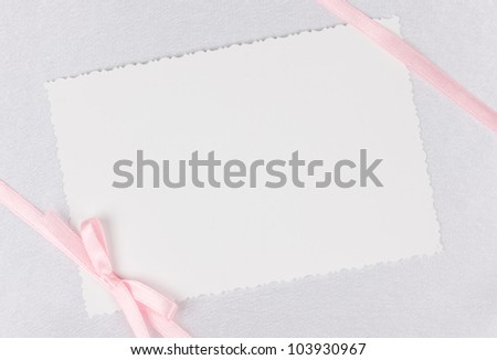 card for text and pink ribbon on white silk