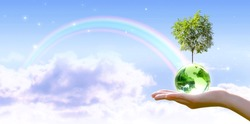 Card for World Earth Day. Planting trees, Ozone Day concept. Saving environment, save and protect green planet and ecology. Earth globe and growing tree in hand on stars sky and rainbow background.