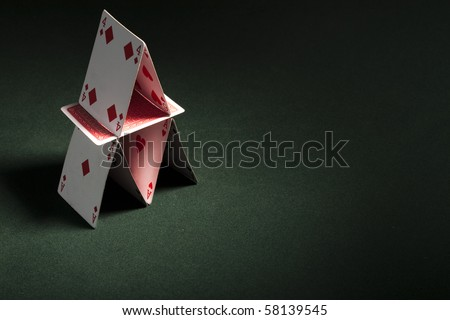 Card house made on green casino table