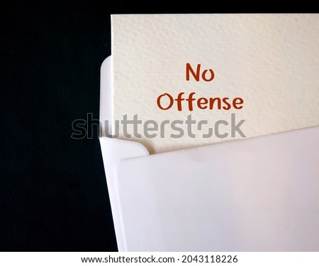 Card in envelope with text written NO OFFENSE ,to indicate the listener not to feel hurt, angry, or upset by what is about to be saidalthough it may seem rather rude. Foto stock ©