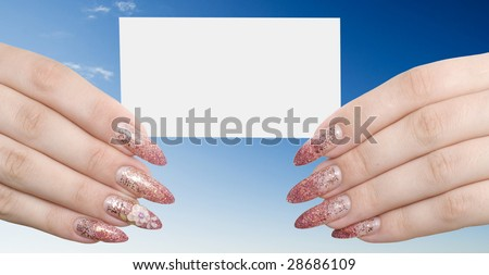 card in hands on a blue sky background