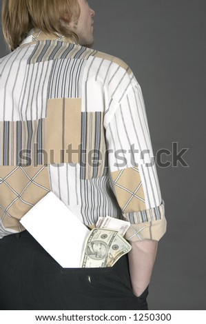 Card located in a back pocket of trousers with money