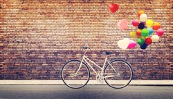Card of bicycle vintage with heart balloon on road urban city concept of love in summer and wedding honeymoon