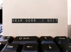 Card on keyboard typed DEAR BOSS I QUIT, concept of employee making decision to quit corporate day job , unhappy worker giving up working 9 to 5 , change job or start their own business