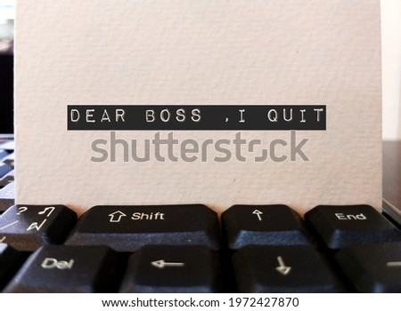 Card on keyboard typed DEAR BOSS I QUIT, concept of employee making decision to quit corporate day job , unhappy worker giving up working 9 to 5 , change job or start their own business Сток-фото ©