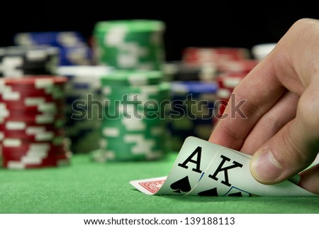 Card player checks his hand