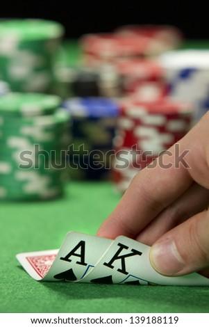 Card player checks his hand - stock photo
