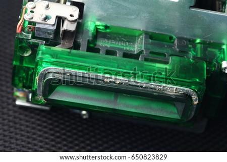Card reader part for atm machine put on dark background scene. #650823829