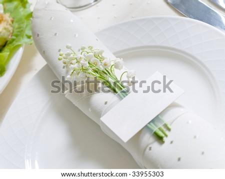 card with flowers on a banquet table
