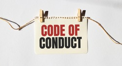 Card with text CODE OF CONDUCT. Diagram and white background