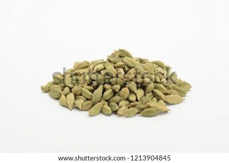 Cardamom grain on white background #1213904845