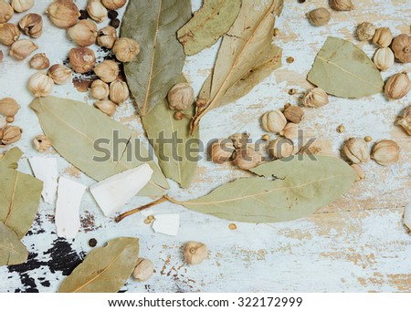 Cardamom, laurel leaves and coriander on the white rustic table. Background