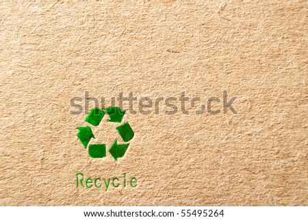 cardboard box background with green recycle symbol