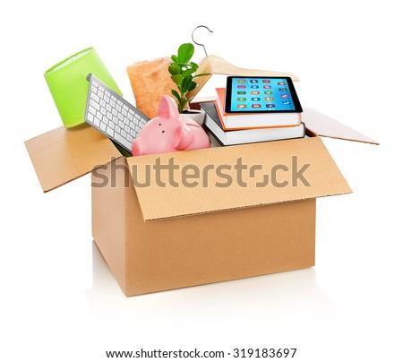 Cardboard box full with household stuff