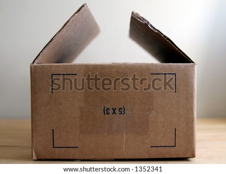 Cardboard box: This End Up. - stock photo