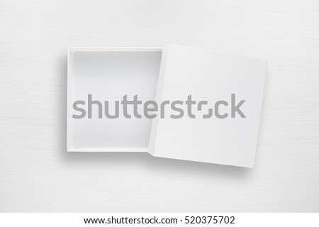 Cardboard box with cover on white table top view