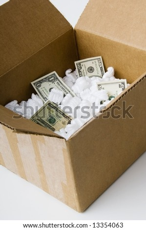 Cardboard box with packaging and money
