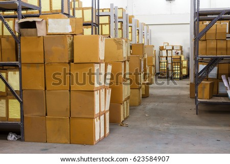 Cardboard box with products in the warehouse