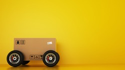 Cardboard box with racing wheels like a car on a yellow background. Fast shipping by road