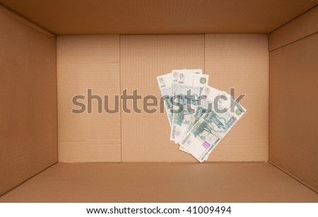 Cardboard box with russian money