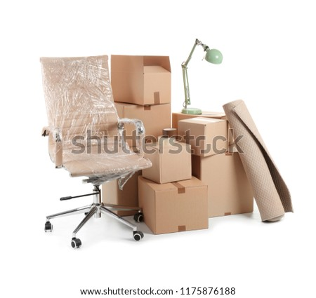 Cardboard boxes and household stuff on white background. Moving day