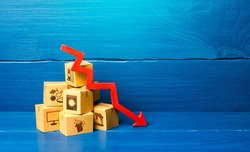 Cardboard boxes and red down arrow. Decline in sales and production volumes. Depressed economy. Low business activity. Economic recession, skepticism and pessimism. Competitiveness of national goods.