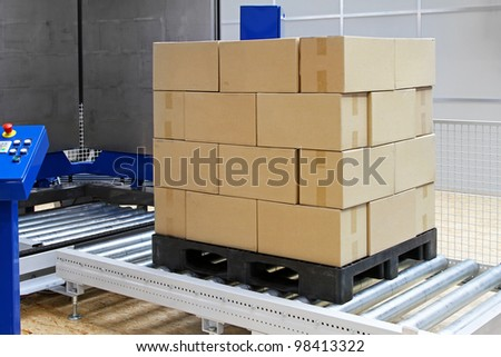 Cardboard boxes at transport pallet package machine