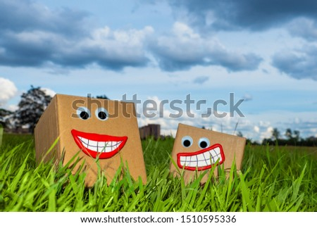 Cardboard boxes for packaging of goods. Corrugated box production. Cartons in the open. Carton stand on the grass. Dispatch of goods. Sale of packaging materials. Warehouse in nature.
