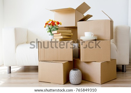 Cardboard boxes - moving to a new house #765849310
