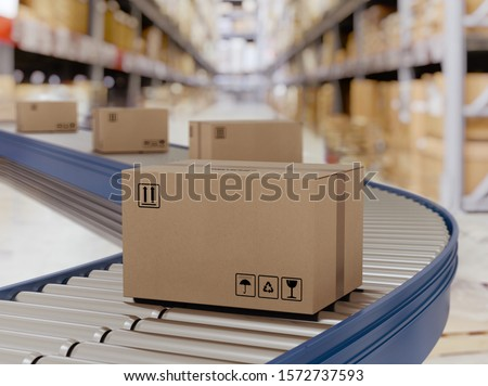 Cardboard boxes on conveyor rollers ready to be shipped by courier for distribution. Stock photo ©